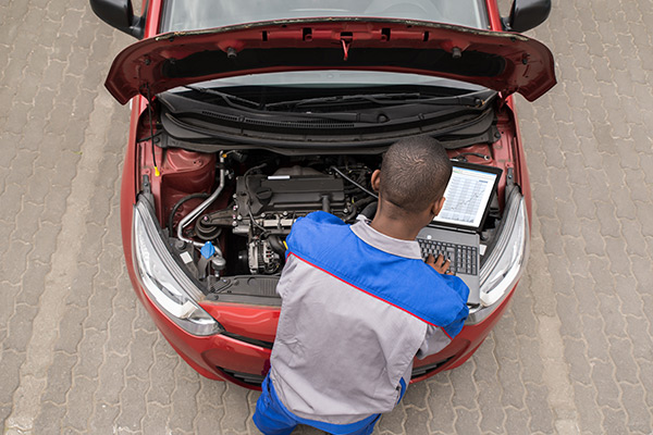 Mechanic running diagnostics on a car