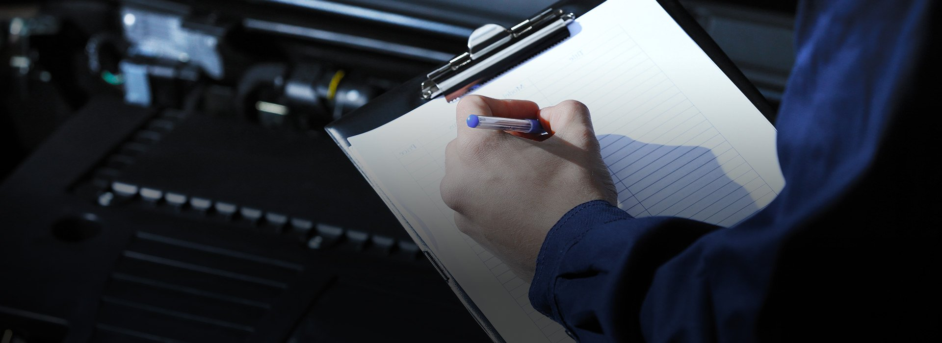 Mechanic with mot checklist