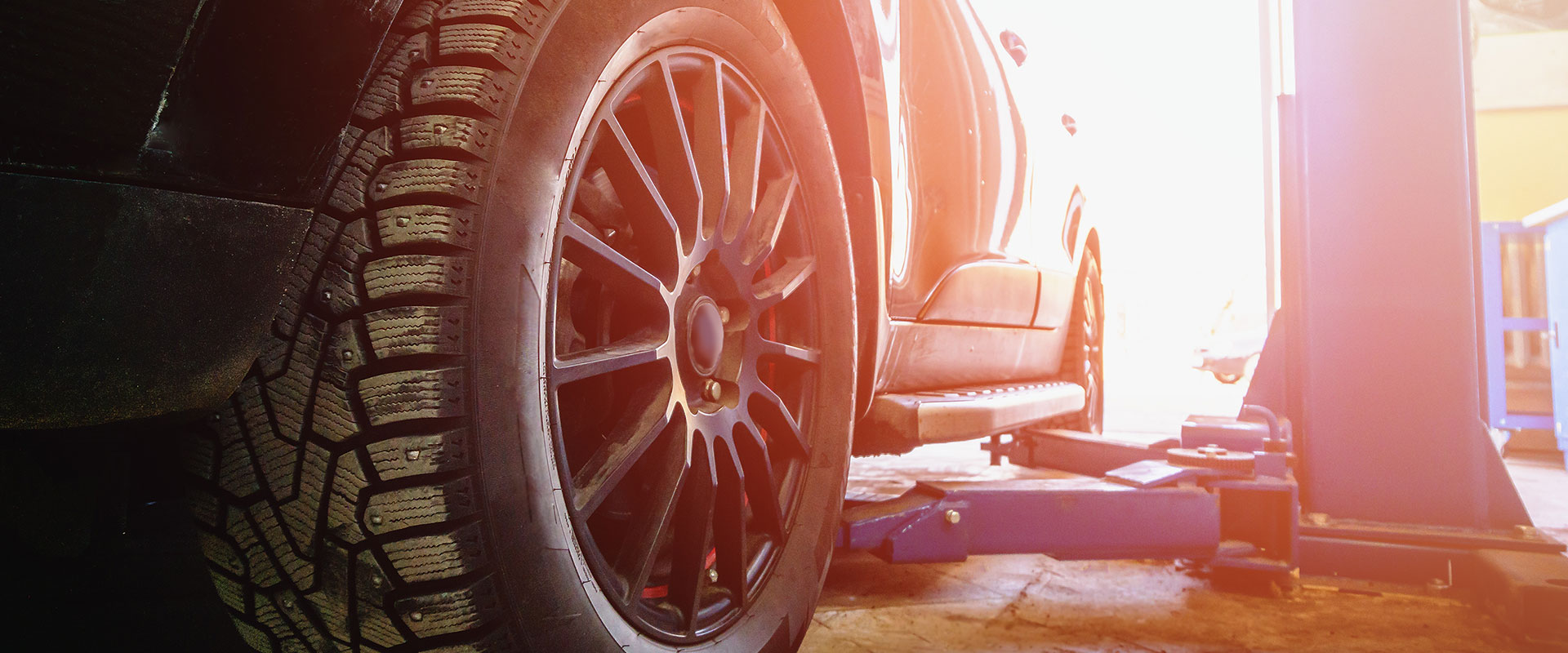 Car on a ramp with tyre in focus